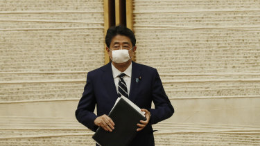 """I will defend the Japanese economy at any cost against this once-in-a-century crisis,"" Shinzo Abe said."