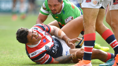 Wounded bird: Latrell Mitchell in pain after appearing to get injured while crossing for a try.