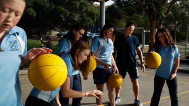 Drills: Belmont High School teacher Brett Lambkin with his year 10 physical education students.