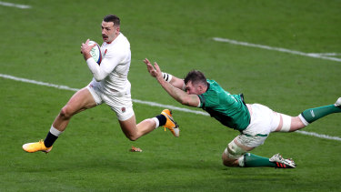 Jonny May outstrips Peter O'Mahony for his length-of-the-field try on Saturday.