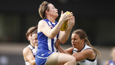 Jess Duffin flies for North Melbourne.