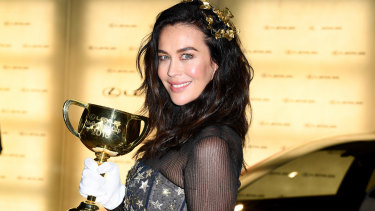 Megan Gale poses for a photograph with the Melbourne Cup last year. This year she will not attend.