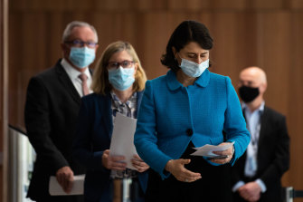 NSW Premier Gladys Berejiklian on Thursday, with Chief Health Officer Dr Kerry Chant and Health Minister Brad Hazzard following behind her.