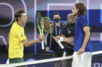 Greece's Stefanos Tsitsipas, right, is congratulated by Australia's Alex de Minaur, left, at Melbourne Park.