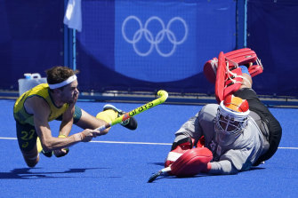 Flynn Ogilvie lands one of the penalties to help Australia to the semis in the men's hockey competition.