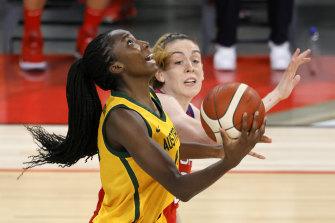 Ezi Magbegor of the Opals shoots against Breanna Stewart of the USA in Las Vegas.