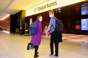Abigail McKinstry and fiance Jack Drummond prepare to depart Melbourne to fly back to New Zealand to get married after a long wait for flights to resume.