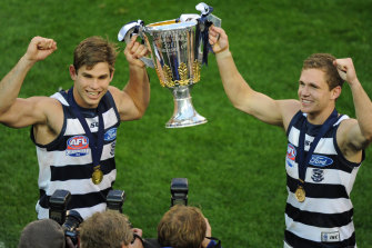 Tom Hawkins and Joel Selwood after the 2011 grand final.