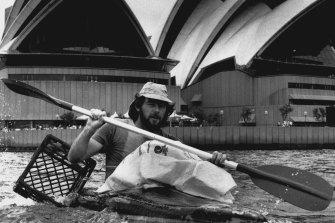 Ken Evans from Paddlers for Peace with a canoe of rubbish.