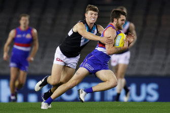 Bailey Williams is chased by Mitch Georgiades.