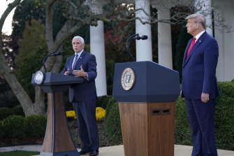 US Vice-President Mike Pence thanks President Donald Trump for his leadership on the COVID vaccine effort, during a press conference on Operation Warp Speed at the White House on Saturday (AEDT).