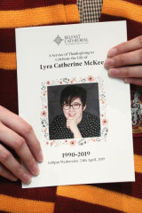 A mourner holds the order of service from Lyra McKee's funeral in Belfast.