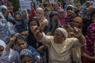 Kashmir Muslim women protesters shout anti Indian slogans during a protest against Indian rule and the revocation of Kashmir's special status, in Srinagar, the summer capital of Indian administered Kashmir, India.