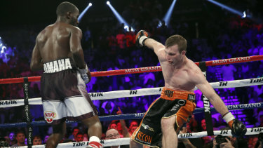 Fighting the very best: Terence Crawford, left, knocks Jeff Horn off balance.