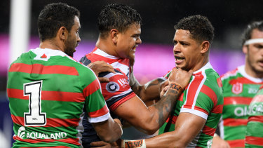 Not a grub: Sam Burgess has leapt to the defence of Roosters star Latrell Mitchell (centre).