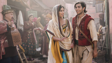 Naomi Scott as Princess Jasmine and Mena Massoud as Aladdin.