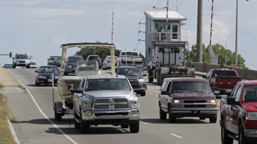 People drive over a drawbridge in Wrightsville Beach, NC as they evacuate the area in advance of Hurricane Florence.