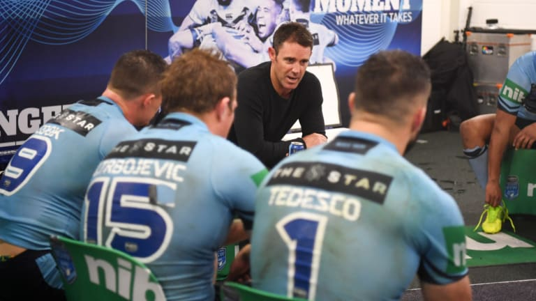 Back to earth: Brad Fittler addresses his troops in Brisbane.