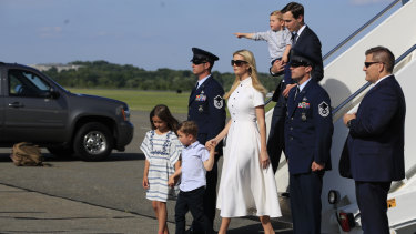 Ivanka Trump and White House Senior Adviser Jared Kushner and their children Arabella, Joseph and Theodore Kushner, disembark Air Force One.