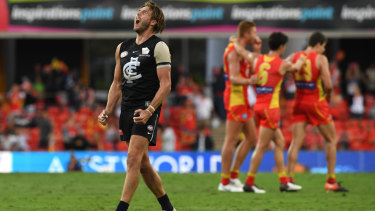 Daisy pain: Carlton's Dale Thomas can't believe it after Gold Coast snatch victory in the dying seconds at Metricon Stadium.
