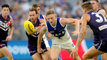 Closed out: North's Jack Ziebell attempts to break through a Fremantle pack.