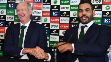 Take care: Greg Inglis enjoys a light moment with Wayne Bennett at the press conference to announce his retirement.