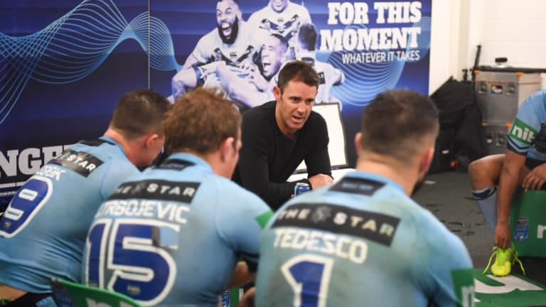 Feeling blue: Brad Fittler addresses his NSW side after their game III defeat.