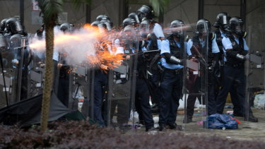 Police shooting tear gas at protesters during the rally against an extradition bill outside the Legislative Council.