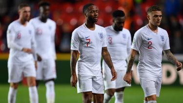 'If one person is abused then we all are': Raheem Sterling and Kieran Trippier after losing to Czech Republic at Sinobo Stadium. They will consider leaving the field if any of the England team are subjectd to fan racism against Bulgaria.