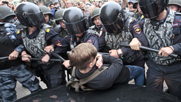 A government plan to increase the age for collecting state pensions brought protests across Russia's 11 time zones on Sunday. Nearly 300 people were reported arrested.