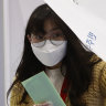 Gloves, sanitiser and ballots: South Korea votes amid pandemic
