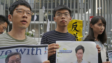 Pro-democracy activists, from right, Agnes Chow, Joshua Wong and Nathan Law.