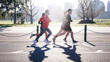 Runners at Melbourne's Albert Park Lake, which has seen a surge of foot traffic during the pandemic.