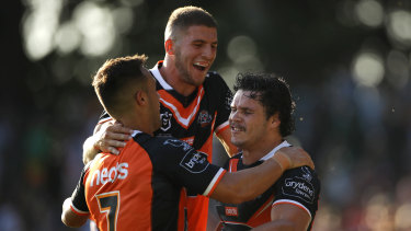 At least one of these three players (Luke Brooks, Adam Doueihi and James Roberts) won't be at the Wests Tigers next year.