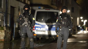 Armed police are seen at the site of a car crash during a carnival procession in Volkmarsen, Germany.