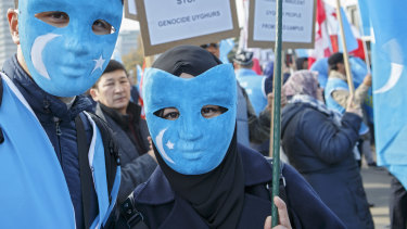 Uyghurs people demonstrate against China on the place des Nations in front of the European headquarters of the United Nations, in Geneva.