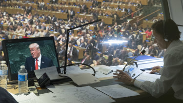 President Donald Trump is seen on a translators video screen as he addresses the 73rd session of the United Nations General Assembly.