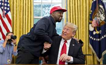 West shakes hands with Trump during a meeting in the Oval Office in 2018.