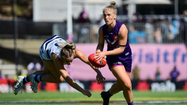 Committed: Fremantle's Jasmin Stewart evades a flying tackle.