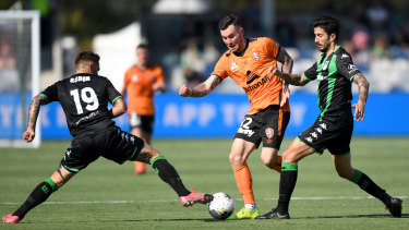 On the run: Brisbane's Aiden O'Neill attempts to sneak past Western United's Josh Risdon.