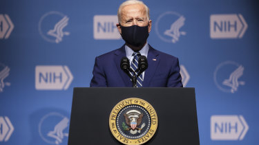 US President Joe Biden wears a protective mask while speaking at the National Institutes of Health (NIH) in Bethesda, Maryland.