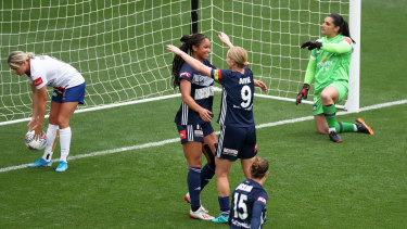 Sharp shooters: Natasha Dowie congratulates Darian Jenkins after Victory go 2-0 up against the Jets.
