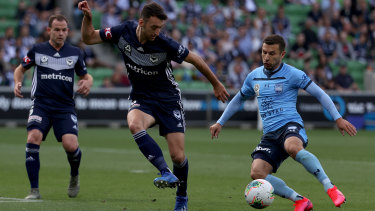 Happy returns: Kosta Barbarouses (right) added to Victory's woes with a goal on his return to AAMI Park with Sydney FC.