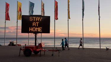 A sign on Manly beach on Wednesday morning.