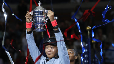 Extraordinary: Naomi Osaka had to fight back tears during a trophy presentation filled with emotion and some boos.