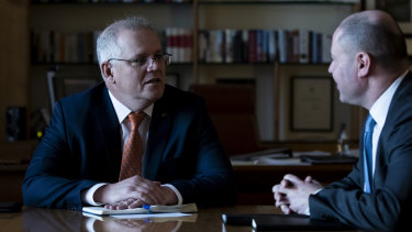 Prime Minister Scott Morrison and Treasurer Josh Frydenberg in discussion after a budget meeting in the PM's office in August.