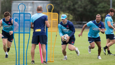 Waratahs players going about their business at training.