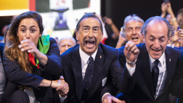 Veni vidi vici: The Mayor of Milan, Giuseppe Sala, center, and members of Milan-Cortina delegation celebrate after winning the bid to host the 2026 Winter Olympic Games.