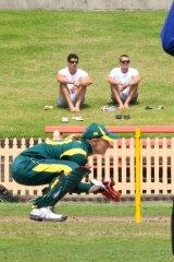 Australian fast bowler Mitchell Starc watches Alyssa Healy wicket keeping for Australia against NZ in 2012.