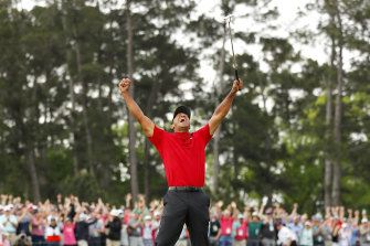 Tiger Woods celebrates after sinking his putt on the 18th green to win during the final round of the Masters in 2019.